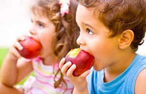 Children eating apples.