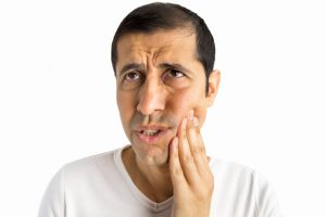 person with a toothache