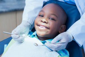 Boy smiles while visiting Bartlesville children's dentist